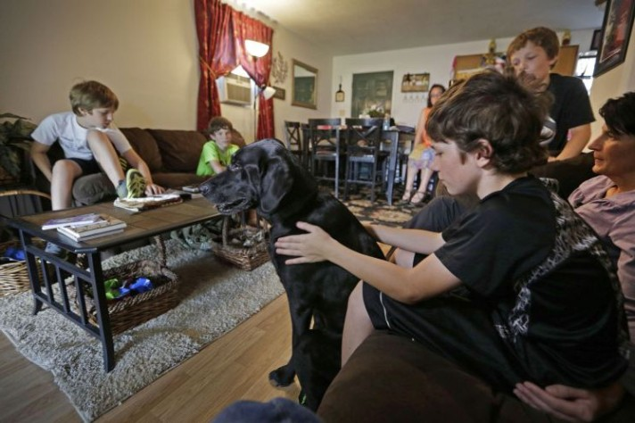 "Honor, the PTSD service dog of her late husband, Wade, at their home in Clyde, N.C. ""Honor gave the boys their dad for more years,"" she says."